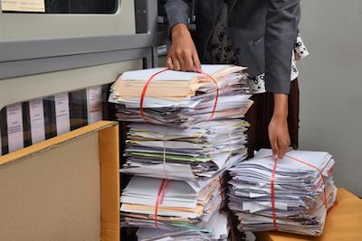 spy cameras capture staff recycling paper bundle