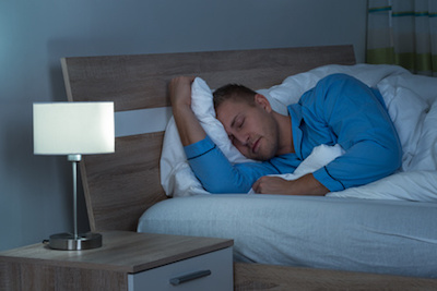 Man Sleeping in Bed with Night Vision Camera Installed
