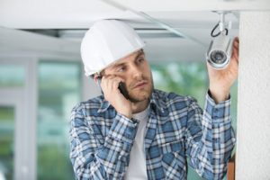 Workman Adjusting Camera